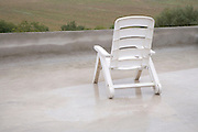 outdoor garden chair on roof terrace on a rainy day