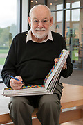portrait of the children book illustrator and artist Eric Carle signing a book, 2006