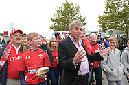 ITV Rugby World Cup 2015 Presenter John Inverdale presenting outside Twickenham Stadium with Wales fans before k/o.  Rugby World Cup 2015 quarter final match, South Africa v Wales at Twickenham Stadium in London, England  on Saturday 17th October 2015.<br /> pic by  John Patrick Fletcher, Andrew Orchard sports photography.