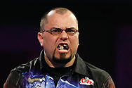 Raymond Smith celebrating winning a leg so hard his teeth fell out, during the PDC World Championship darts at Alexandra Palace, London, United Kingdom on 14 December 2018.