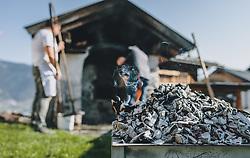 THEMENBILD - der Bäcker holt die Glut aus dem Backofen. Am Karfreitag bäckt die Bäckerei Gugglberger zum ersten Mal im Jahr Bauernbrot und Milchbrot bzw. Osterstriezel, im alten, traditionellen Holzofen neben dem Meixnerhaus am Kirchbichl oberhalb von Kaprun, aufgenommen am 10. April 2020 in Kaprun, Oesterreich // the baker takes the embers out of the oven. On Good Friday the bakery Gugglberger bakes farmhouse bread and milk bread or Osterstriezel for the first time in the year, in the old, traditional wood oven next to the Meixnerhaus at the Kirchbichl above Kaprun in Kaprun, Austria on 2020/04/10. EXPA Pictures © 2020, PhotoCredit: EXPA/Stefanie Oberhauser