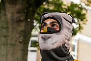 An activist wearing panda outfit looks up as others play drums in Canonbury Road, nearby Highbury and Islington Station, on Thursday, Oct 1, 2020 to mark the 'National Tree Killing Day' outside the Dixon Clark Court development plan. (VXP Photo/ Sabrina Merolla)
