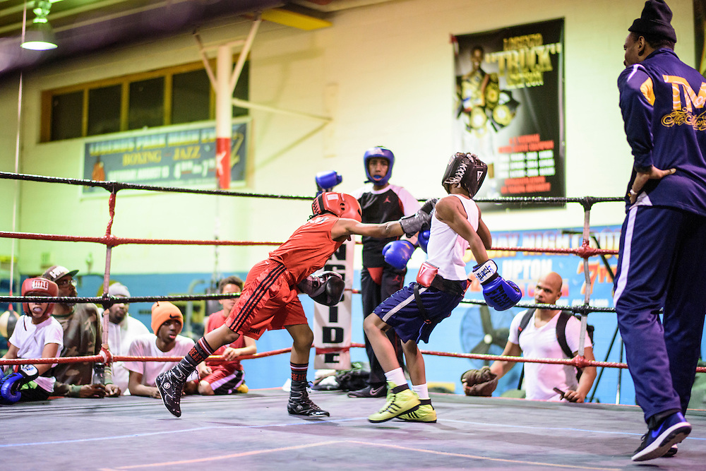 """Baltimore, Maryland - January 26, 2017: Nieem """"The Brutal Machine"""" Somerville, 10, left, spars with another boxer at the Upton Boxing Club in West Baltimore Wednesday January 26, 2017. <br /> Upton Boxing Club coach Calvin Ford is on the right.<br /> <br /> Upton Boxing Club is where Coach Calvin Ford, the inspiration for character Dennis """"Cutty"""" Wise from """"The Wire,"""" coaches. It's also the gym where Gervonta Davis, the current IBF junior lightweight champion, trains. Davis is undefeated (17-0) with 16 KOs. He also coaches dozens of amateurs and a few other professionals.<br /> <br /> CREDIT: Matt Roth for The New York Times<br /> Assignment ID: 30201545A"""