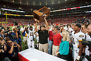 September 05 2009     Mizzou head coach Gary Pinkel holds aloft the State Farm Arch Rivalry trophy surrounded by his team and members of the media.   The University of Missouri hosted the University of Illinois in the annual Arch Rivalry Football Game at the Edward Jones Dome in downtown St. Louis on September 5, 2009.  The Mizzou .Tigers won, 37-9...            *******EDITORIAL USE ONLY*******