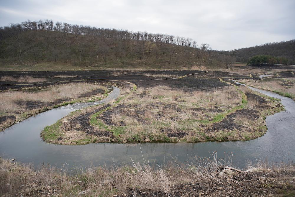 A prescribed burn for prairie restoration along Waterloo Creek in the Driftless Region of Iowa.