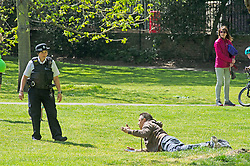 ©Licensed to London News Pictures 06/05/2020  <br /> Greenwich, UK. Police officer on patrol asking this man to move on.  People out and about in Greenwich park, Greenwich, London exercising and enjoying the warm sunny weather.  Photo credit:Grant Falvey/LNP