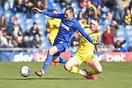 Oxford United defender Sam Long (23) tackles AFC Wimbledon midfielder Dylan Connolly (16) during the EFL Sky Bet League 1 match between Oxford United and AFC Wimbledon at the Kassam Stadium, Oxford, England on 13 April 2019.