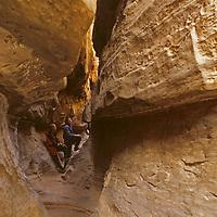 Hikers explore a siq [slot canyon] on Jebel [Mount] Khaz Ali in Jordan's Wadi Rum.  (MR)