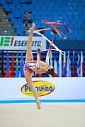 Halkina Katsiaryna during qualifying at ribbon in Pesaro World Cup 11 April 2015.   Katsiaryna is a Belarusian rhythmic gymnastics athlete born  February 25, 1997 in Minks, Belarus.