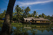 Kerala, located on the Southwestern tip of India, enjoys unique geographical features that have made it one of the most sought-after tourist destinations in Asia. The region connects the rivers of the Western Ghats with the mystical Arabian Sea. Historically the brackish lagoons and lakes lying parallel to the Sea were used for transporting coconuts & palms inland but nowadays the network of interconnected canals and rivers are largely home to a unique eco-system. Freshwater from the rivers meet the seawater from the Arabian Sea and an  eclectic collection of charismatic bamboo house boats provide jobs for the local Malayalam communities in the form of tourist cruises, gliding silently through the impressive green landscapes of the backwaters. Fondly referred to as 'God's Own Country', Kerala was selected by the National Geographic Traveller as one of the 50 destinations of a lifetime and one of the thirteen paradises in the world.