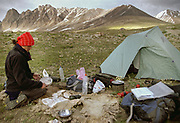 """Below the 3rd pass separating us from the Little Pamir at a pasture area called  Barnoz, we try our first attempt at some kind of meat ravioli. Not so successful, but the boiled dough tasted meaty! Shpodkis (""""Rhubarb"""") Valley.<br /> <br /> Adventure through the Afghan Pamir mountains, among the Afghan Kyrgyz and into Pakistan's Karakoram mountains. July/August 2005. Afghanistan / Pakistan."""