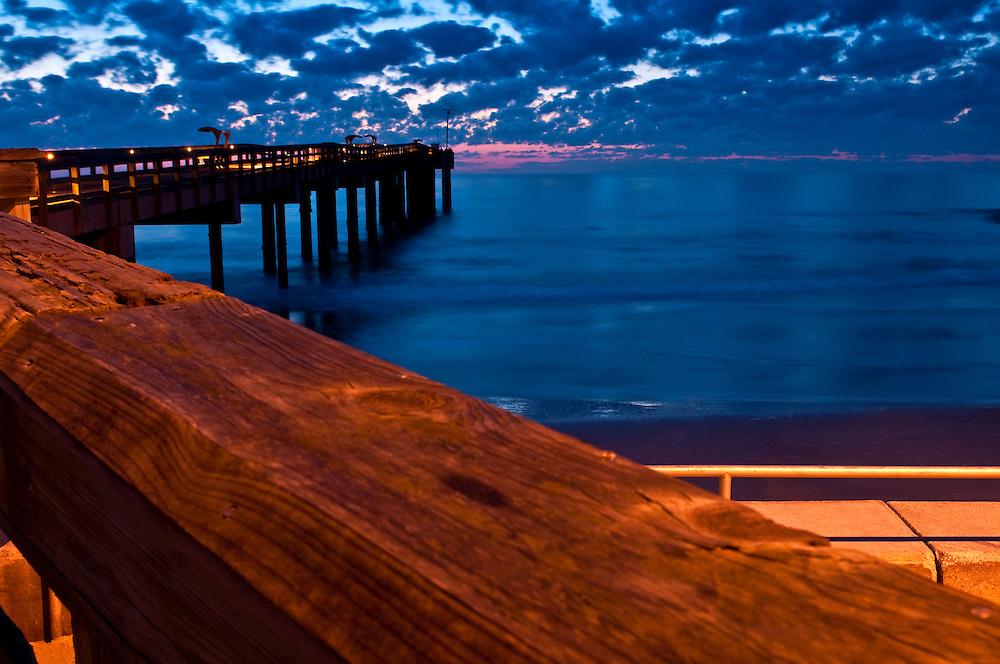 Sunise in St. Augustine Beach fishing pier, Florida.