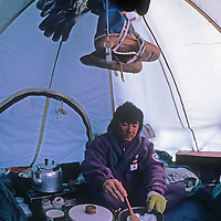 Keizo Funatsu melts snow for water in his tent at the South Pole, halfway through the 1989-1990 Trans-Antarctica Expedition.