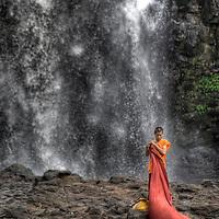 Young Monk dresses below Bousra Waterfall in Sen Monorom, Mondulkiri province, Cambodia