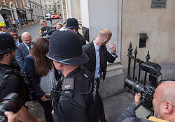 © Licensed to London News Pictures. 08/08/2018. Bristol, UK. England cricketer BEN STOKES (right, hiding face) arrives at Bristol Crown court for the third day of his trial on charges of affray that relate to a fight outside a Bristol nightclub on September 25 2017. Stokes and two other men, Ryan Ali, 28, and Ryan Hale, 27, all deny the charge. Stokes, Ali and Hale are jointly charged with affray in the Clifton Triangle area of Bristol on September 25 last year, several hours after England had played a one-day international against the West Indies in the city. A 27-year-old man allegedly suffered a fractured eye socket in the incident. Photo credit: Simon Chapman/LNP