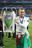KIEV, UKRAINE - MAY 26: Gareth Bale of Real Madrid with a trophy after winning the UEFA Champions League final between Real Madrid and Liverpool at NSC Olimpiyskiy Stadium on May 26, 2018 in Kiev, Ukraine. (MB Media)