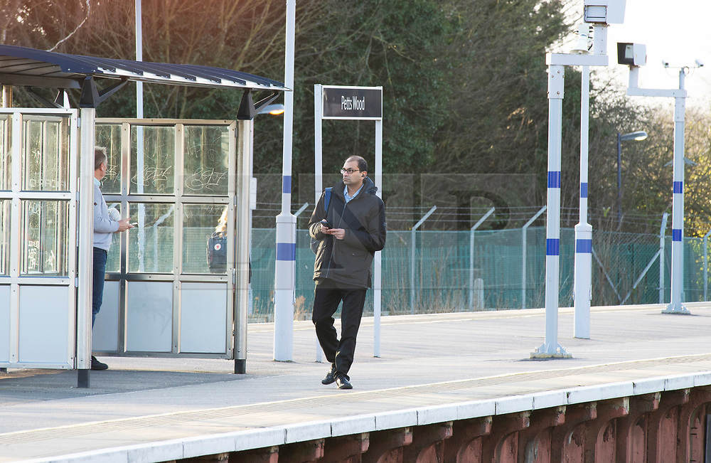 ©Licensed to London News Pictures 13/03/2020<br /> Pettswood, UK. A quiet half empty train station platform. London commuters at Pettswood train station this morning in Pettswood, Kent are keeping their distance from each other by standing a meter apart as the Coronavirus threat continues in the UK. Commuter numbers are down as many work from home.  Photo credit: Grant Falvey/LNP