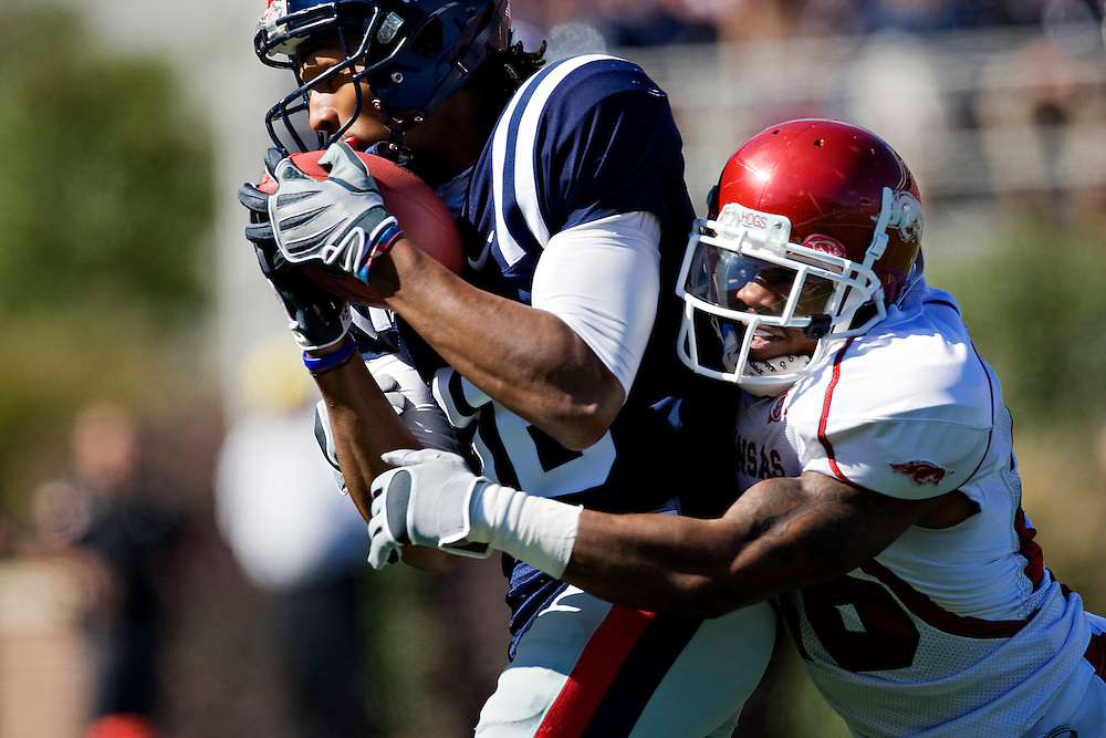 OXFORD, MS - OCTOBER 24:   Ramon Broadway #26 of the Arkansas Razorbacks tackles Markeith Summers #16 of the Ole Miss Rebels at Vaught-Hemingway Stadium on October 24, 2009 in Oxford, Mississippi.  The Rebels defeated the Razorbacks 30 to 17.  (Photo by Wesley Hitt/Getty Images) *** Local Caption *** Ramon Broadway; Markeith Summers