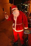 Israel, Haifa, Wadi Nisnas, young man dressed up as Santa Claus during the Holiday of holidays festival, celebrating Hanuka-Christmas-Ramadan festival in the Haifa Neighbourhood of Wadi Nisnas
