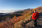 Photographer capturing view of the mountains surrounding Park City in (Fall), Autumn showing colour, Utah, United States of America