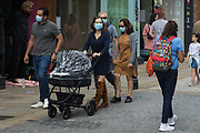 Shoppers wear face coverings to help prevent the spread of the coronavirus on 26th August 2020 in Windsor, United Kingdom. Tessa Lindfield, the Director of Public Health for Berkshire, has urged residents of the Royal Borough of Windsor and Maidenhead to follow social distancing guidelines following a significant rise in the number of positive COVID-19 tests there over the past week.