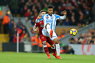 Elias Kachunga of Huddersfield Town gets in front of Alberto Moreno of Liverpool. Premier League match, Liverpool v Huddersfield Town at the Anfield stadium in Liverpool, Merseyside on Saturday 28th October 2017.<br /> pic by Chris Stading, Andrew Orchard sports photography.
