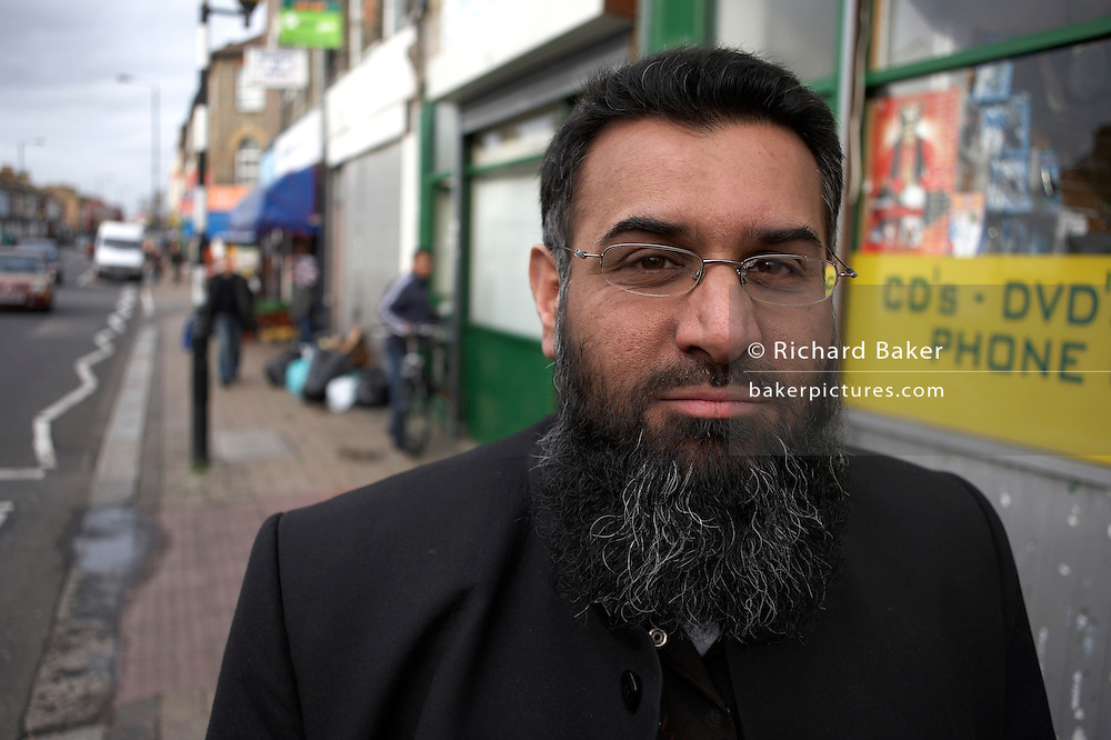 Wearing a long beard of a strict Musilm, Anjem Choudary is a deputy and main UK spokesman of the Islamist group al-Muhajiroun whose leader, Omar Bakri Mohammad is a radical who caused controversy after the London attacks of July 2007, declaring that the only people he blames for the bombings are the government and British public. Choudary, a lawyer by profession, stands outside in the street in Leyton, north-east London England. There are few people in the background but Choudary commands much respect among activists in the UK. He organised and was fined in court for the Danish Embassy rally in February 2006 at which participants called for the massacre of those who insult Islam though Choudary refutes knowledge of who wrote such threats.