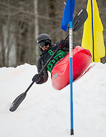 Derek Tremblay takes a high line on the berm during Saturday's Boat Bash Snow Crash at the Veteran's Memorial Ski Hill in Franklin.  (Karen Bobotas/for the Laconia Daily Sun)