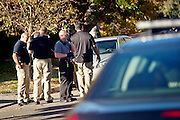 Salt Lake City Police Department officers congregate across the street from an armed home invasion shooting at 2300 Green Street in Salt Lake City, Tuesday, Oct. 30, 2012.