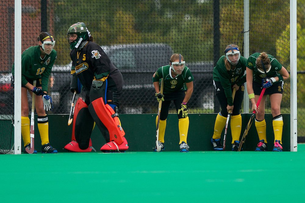 Catamounts midfielder Alana Izzo (13),Catamounts goalie Stephanie Zygmunt (5),Catamounts forward Taylor Silvestro (6), Catamounts midfielder Callie Bellimer (11) and Catamounts midfielder Whitlee Burghardt (2) wait for a corner during the women's field hockey game between the Maine Black Bears and the Vermont Catamounts at Moulton/Winder Field on Saturday afternoon September 29, 2012 in Burlington, Vermont.