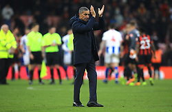 Brighton & Hove Albion manager Chris Hughton applauds the fans after the final whistle during the Emirates FA Cup, third round match at the Vitality Stadium, Bournemouth.