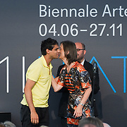 VENICE, ITALY - JUNE 04:  Bice Curiger Director of 54th Biennale Art 2011 (R) welcomes on stage artist Haroon Mirza (R) at the Official Awards  of the 54th International Art Exhibition on June 4, 2011 in Venice, Italy. This year's Biennale is the 54th edition and will run from June 4th until 27 November.