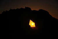 sunset inside the pedra furada bored rock beach main attraction in the beautiful fisherman village of Jericoacoara in ceara state brazil
