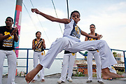Local Capoeira group practicing at the top of Vidigal - Avrao. Since pacification in 2011, Vidigal has slowly become known as what some call a model favela, seen as the safest favela in Rio, home to a mixed community which now includes foreigners, hostels, restaurants, theatres and creative businesses.