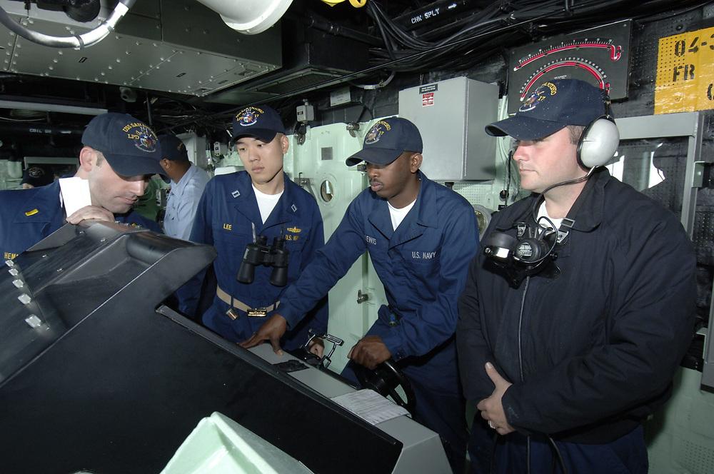Port Aransas, TX January 15, 2006: Maiden voyage of the USS San Antonio (LPD-17) amphibious transport dock after her commissioning ceremony 14Jan.   Navy sailors on the ship's bridge plot the ship's course through the Aransas Channel. ©Bob Daemmrich /