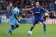 AFC Wimbledon midfielder Mitchell (Mitch) Pinnock (11) tracking back during the EFL Sky Bet League 1 match between AFC Wimbledon and Coventry City at the Cherry Red Records Stadium, Kingston, England on 11 August 2018.