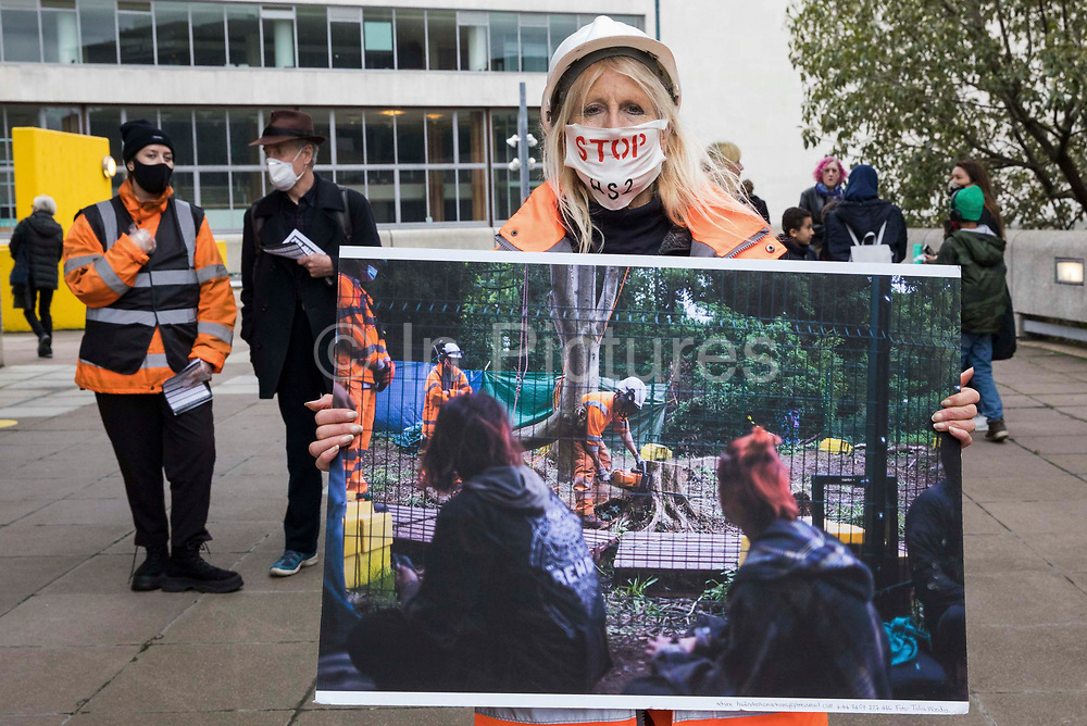 Activists dressed as HS2 security guards and workers take part in a HS2 Chainsaw Massacre protest outside the Among The Trees exhibition at the Hayward Gallery on 30 October 2020 in London, United Kingdom. The protest was intended to highlight both the daily environmental destruction being wrought for the controversial HS2 high-speed rail project and instances of violence and brutality by security guards and bailiffs working on behalf of HS2 Ltd.