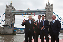 © licensed to London News Pictures. London, UK 27/06/2012. Mayor of London Boris Johnson, Culture Secretary Jeremy Hunt, Lord Sebastian Coe and the Chair of the London Organising Committee of the Olympic Games unveil giant Olympic rings which are displayed from Tower Bridge, today. Photo credit: Tolga Akmen/LNP