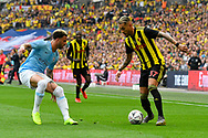 Roberto Pereyra (37) of Watford looks for a way past Kyle Walker (2) of Manchester City during the The FA Cup Final match between Manchester City and Watford at Wembley Stadium, London, England on 18 May 2019.
