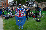 Steve Bray of pro remain protest group Stand of Defiance European Movement, holding placards behind live news broadcasters  on College Green on 24th May 2019 in London, England, United Kingdom. Todays announcement by Britains Prime Minister to step down on the 7th June has started a leadership race in the Conservative Party.