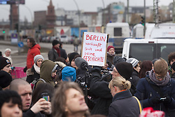 Protesters during the removal of a section of the East Side Gallery, the Berlin Wall. Some 25 meters of this section of the wall that mostly came down 23 years ago and marked the end of the cold war are taken away to make way for a new housing development on river Spree, a project called Living Levels, Berlin, Germany,  March 1, 2013. Photo by Imago / i-Images...UK ONLY