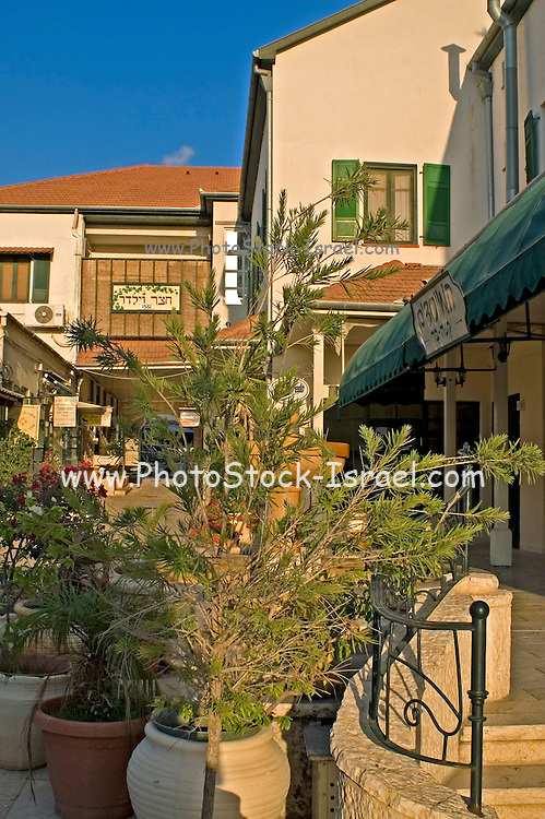 A courtyard of the historic street, now a pedestrian street, Zikhron Ya'aqov Israel, Zihron Yaaqov; also Zichron Yaakov (meaning Jacob's memorial) was established 1882 on Mount Carmel, by pioneers from Romania, members of Hovevei Zion movement. In 1883 Baron Edmond James de Rothschild became the patron of the new settlement. The place was named in memory of his father, James (Jacob) Mayer de Rothschild. In 1885 Rothschild helped to establish the first winery in the country in Zikhron Ya'aqov.
