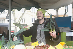 Mid adult man selling fruits and vegetables in the market, Freiburg im breisgau, Baden-wuerttemberg, Germany