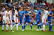 Peterborough United midfielder Mark O'Hara (8) and Peterborough United defender Ryan Tafazolli (5) get ready for this corner  the EFL Sky Bet League 1 match between Peterborough United and Luton Town at London Road, Peterborough, England on 18 August 2018.
