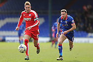 Mike Jones of Oldham Athletic puts Gary Liddle of Chesterfield  under pressure during the Sky Bet League 1 match between Oldham Athletic and Chesterfield at Boundary Park, Oldham, England on 28 March 2016. Photo by Simon Brady.