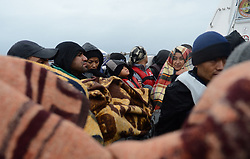 Refugees who cover their bodies with blankets are seen on a boat after they rescued by Turkish coast guards while they were illegally trying to reach Greece's Lesbos island through the Aegean Sea, in Canakkale province of Turkey on October 27, 2015. Refugees who begin a journey with a hope to have high living standards away from conflicts, use Greece's Lesbos Island as a transit point on their way to Europe. Photo by Ali Atmaca/AA/ABACAPRESS.COM  | 521549_038 Canakkale Turquie Turkey