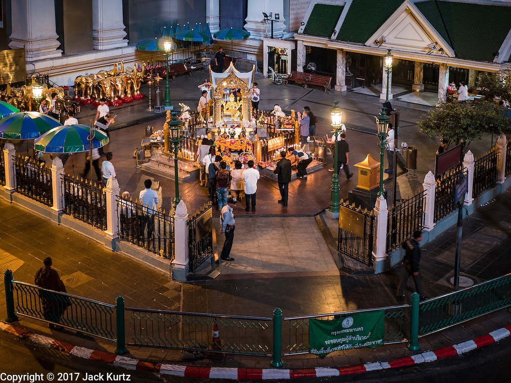 01 JANUARY 2017 - BANGKOK, THAILAND:         Thais visit Erawan Shrine in Bangkok before sunrise on New Year's Day. Thais traditionally go to temples to pray and make merit on New Year's Day. There are also large merit making ceremonies in many towns. The merit making ceremony featured 89 monks to honor Bhumibol Adulyadej, the Late King of Thailand, who died on October 13, several weeks short of his 89th birthday.     PHOTO BY JACK KURTZ