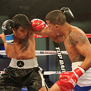 ORLANDO, FL - OCTOBER 04:  Jantony Ortiz (R) punches Gilberto Mendoza during a professional super flyweight boxing match at the Bahía Shriners Auditorium & Events Center on October 4, 2014 in Orlando, Florida. Ortiz would go on to win the fight. (Photo by Alex Menendez/Getty Images) *** Local Caption *** Jantony Ortiz; Gilberto Mendoza