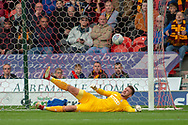 Bradford city goalkeeper Richard O'Donnell as Doncaster Rovers forward John Marquis shoots and scores a goal 1-0 during the EFL Sky Bet League 1 match between Doncaster Rovers and Bradford City at the Keepmoat Stadium, Doncaster, England on 22 September 2018.