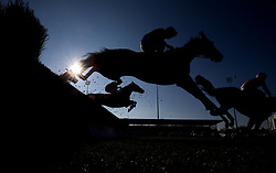 Bags Grove and Noel Fehily clears an early fence before winning The 888Sport Pendil Novices' Steeple Chase Race run at Kempton Park Racecourse.